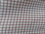Tissu fond blanc avec tissage de fils terracota